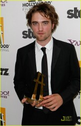 Rob Accepts Award