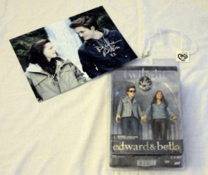 Bid on a Twilight Still Autographed by Kristen Stewart & Robert Pattinson